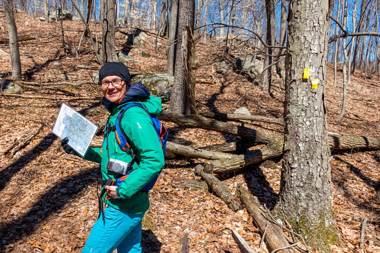 """Karmen leads on the """"Yellow"""" trail. The blazes say turn left."""