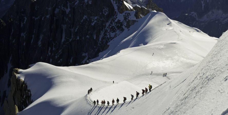Skiers making their way down the ridge into La Valle Blanche