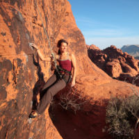 A climber hangs from her rope to admire the view of Red Rocks State Park.