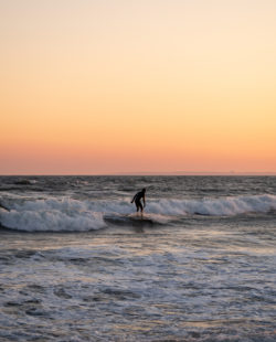 Surfer at Rockaway Beach